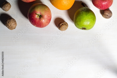 Fruits and nuts on the white wooden table, top view - 168258350