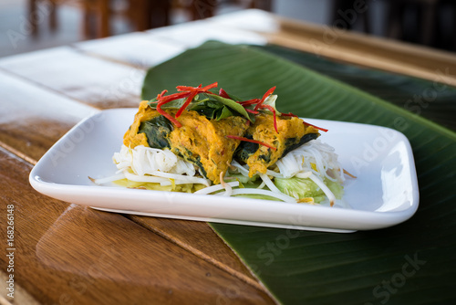 steamed fish with curry paste - 168266148