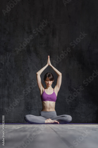 Wall mural Young beautiful fitness female posing in studio