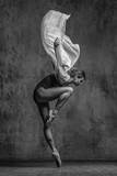Young beautiful dancer is posing in studio - 168284396