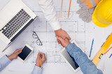 Hands of professional architects discussing and working with blueprints - 168294977