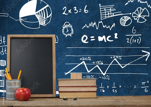 Desk foreground with blackboard graphics of math science diagram