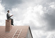 Quadro Student guy in suit on brick house roof reading book