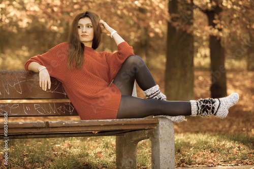 Wall mural Beauty girl in autumnal time relax outdoors.