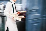Waiter Serving In Motion On Duty in Restaurant Long Exposure - 168348361