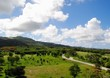 Scenic landscaped gardens and golf course with Mt. Tapochao in the side. Saipan, Northern Mariana Islands