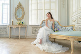 Young attractive bride on wedding gown in studio - 168371994