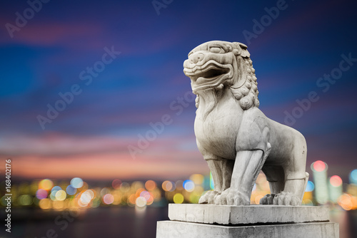 Traditional Chinese stone lions, Bund in Shanghai before the old building Poster