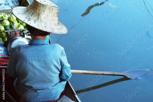 Seller on boat , floating market ,Thailand Poster