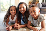 African-American children smiling and lying on floor