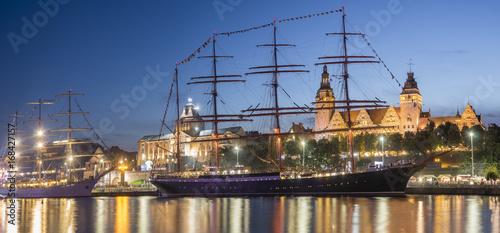 Fotobehang Schip Big sailing ships at night at haken terraces in Szczecin, Tall ship races 2017