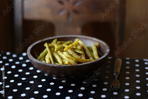 Baked yellow beans in plate. Homemade boiled and baked yellow beans with spice.