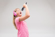 girl with headphones pretending to be a singer