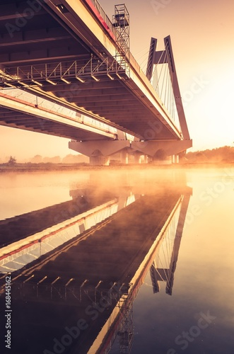Sticker Cable stayed bridge, Krakow, Poland, in the morning fog over Vistula river