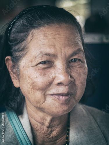 Poster Close up old Thai woman portrait