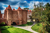 Fototapety Warsaw, Poland: the Warsaw Barbacan, Polish barbakan warszawski in the summer