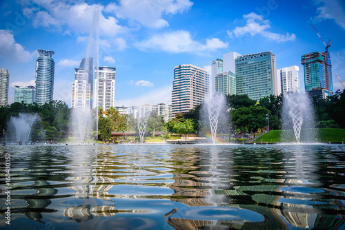 Cityscape of Kuala lumpur city skyline with fountain on blue sky in Malaysia at daytime Poster