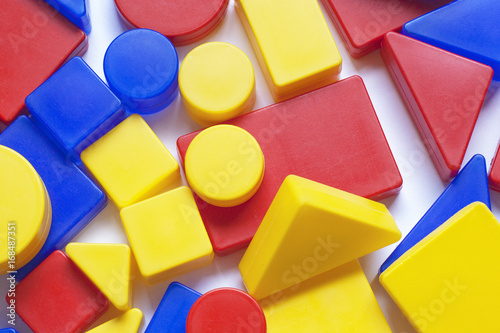 Colored shapes from plastic on white background