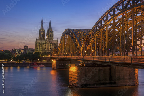 Sticker sunset sky with colors and clouds over the city skyline Cologne with Bridge and Köln Dom ,Evening scene over Cologne/Koln city with Kolner Dom/Cathedral behind the Hohenzollern bridge