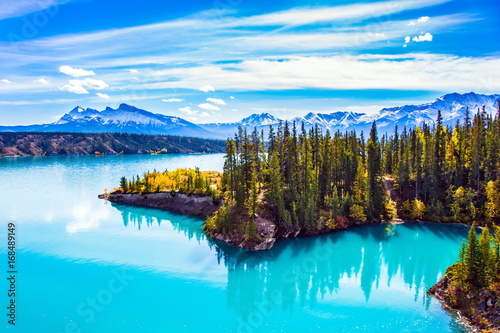 Turquoise smooth water reflects the sky
