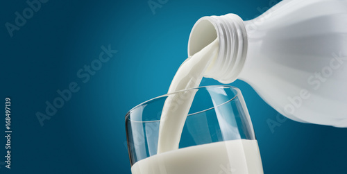 Foto op Aluminium Milkshake Pouring fresh milk into a glass