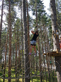 child climbing on rope adventure park