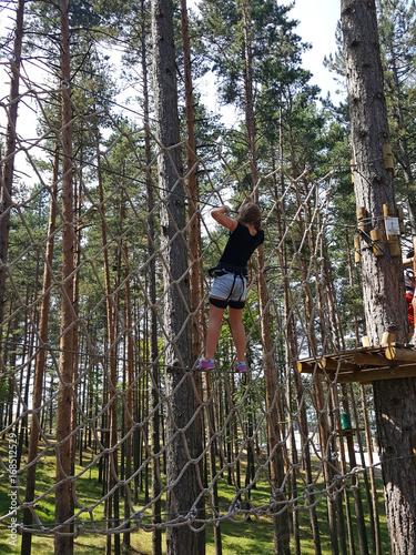 Zdjęcia na płótnie, fototapety, obrazy : child climbing on rope adventure park