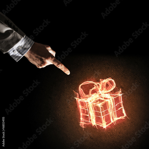 Concept of celebration with fire burning gift symbol and busines Poster