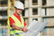 construction worker with blueprint at building area