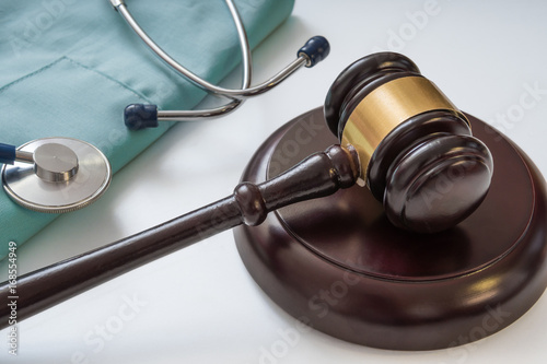 Gavel and stethoscope in background. Medical laws and legal concept.