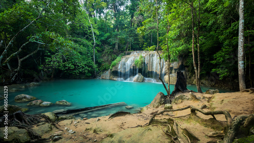 Breathtaking green waterfall at deep forest, Erawan waterfall located Kanchanaburi Province, Thailand - 168562329