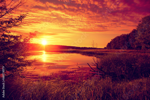 Fotobehang Oranje eclat Early morning, sunrise over the lake. Misty morning, rural landscape, wilderness, mystical feeling