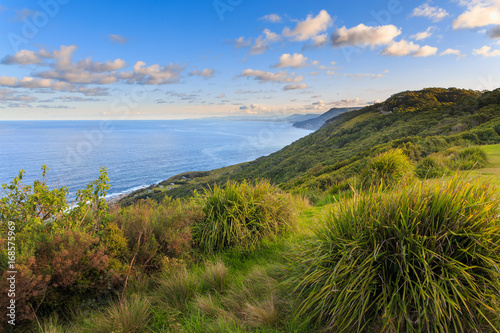 Poster Stanwell Park and Stanwell Beach from the Bald Hill Lookout along the Illawarra Range on the New South Wales coastline, Australia with an elevation of approximately 300 meters.