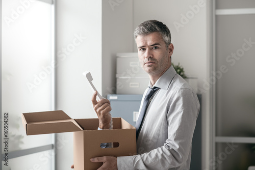 Office worker receiving a surprise call in a box Poster