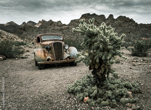 Leinwandbild Motiv Old vintage car truck abandoned in the desert