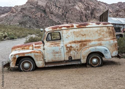 Old vintage car truck abandoned in the desert Poster