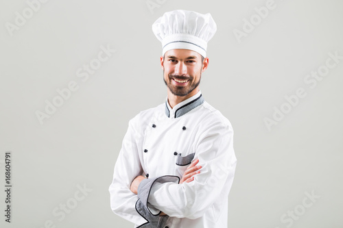 Wall mural Portrait of  chef on gray background.