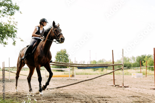 Picture of young pretty girl riding horse Poster