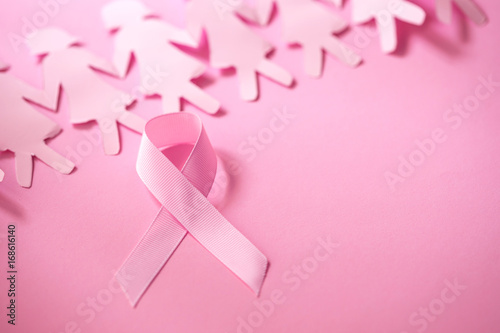 The Sweet pink ribbon shape with girl paper doll on pink background  for Breast Cancer Awareness symbol to promote  in october month campaign - 168616140