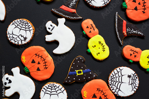 Halloween biscuits with colorful icings baked for the holiday