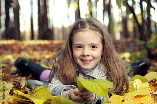 happy girl in leaves autumn