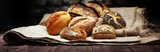 Different kinds of bread and bread rolls on wooden table - 168654191