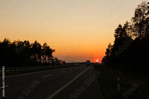 Foto op Aluminium Nacht snelweg Highway traffic in sunset
