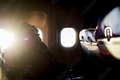 People sleep on the plane, early morning