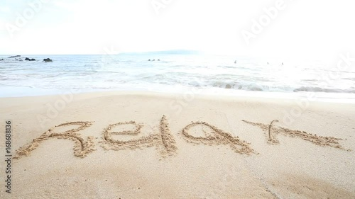 Wall mural The word Relax written in sand on a tropical island beach