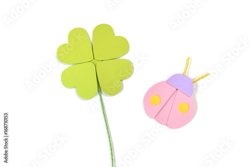 Four leaf clover and ladybug paper cut on white background - isolated Poster