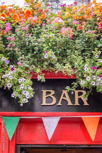Bar sign with flowers and irish flag colors, irish pub concept in Dublin, Irelan Poster