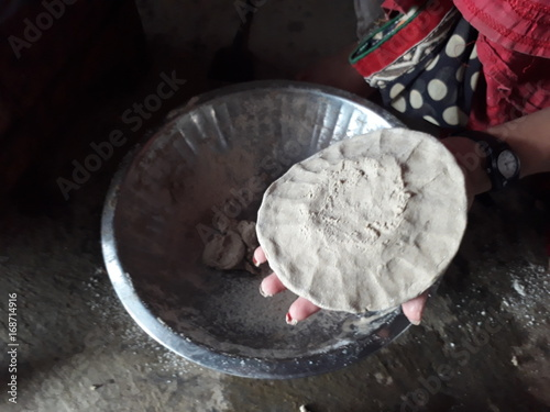 Sticker Indian woman making pearl millet chapatti 3
