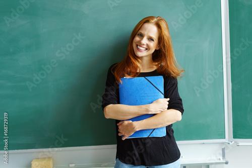 nauczyciel przed tablicą