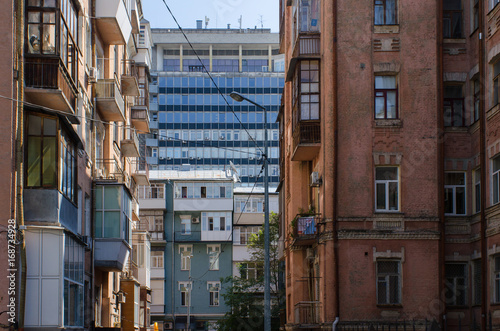 Fotobehang Kiev perspectives in Kiev, capital city of Ukraine, with a multitude of architectural styles meeting in urban scenery
